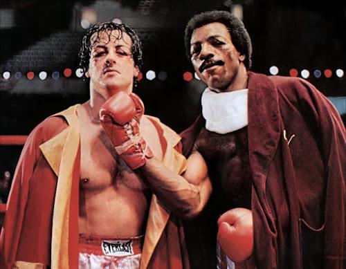 Rocky Balboa e Apolo Creed posando para foto depois da surra