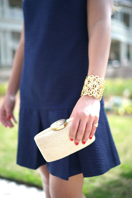 karine sultan gold cuff and kayu straw clutch
