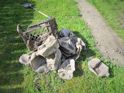 plastic crates milk jug cartons trash in yard dug up