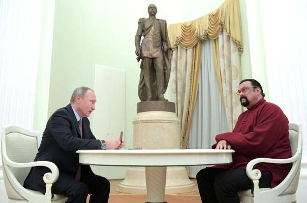 Putin presents Russian passport to Hollywood actor Seagal