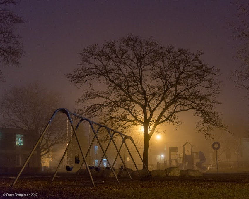 Portland, Maine USA April 2017 photo by Corey Templeton of an ominously foggy scene at the playground outside of Reiche Elementary School.