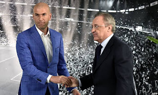 Real Madrid CF president Florentino Perez, right, poses for a picture with Zinedine Zidane, left, as new Real Madrid head coach at Santiago Bernabeu Stadium.