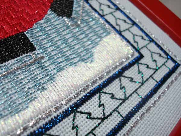 Use Kreinik Ombre in 3200 Pearl for snow drifts in needlepoint