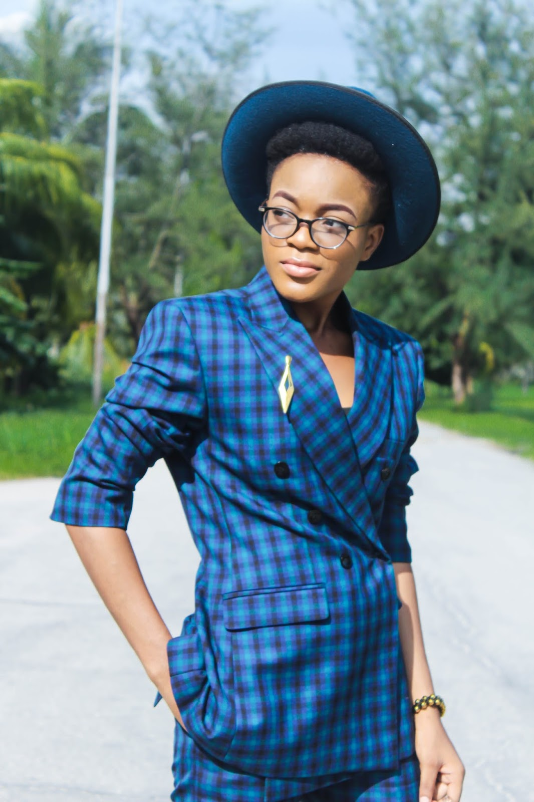 how to dress androgynous female, how to dress like a tomboy, teal blue plaid suit unisex