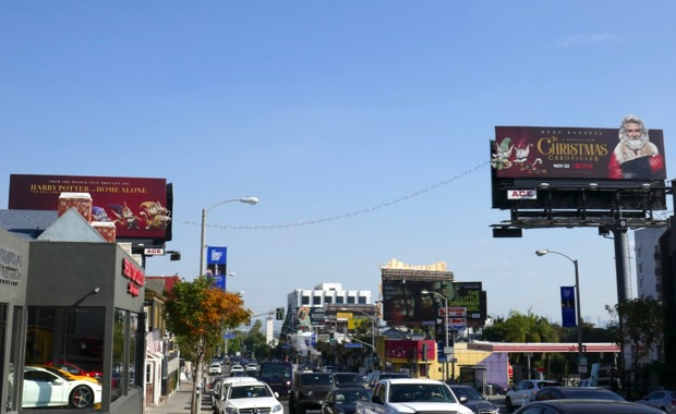 Christmas Chronicles string lights billboards daytime