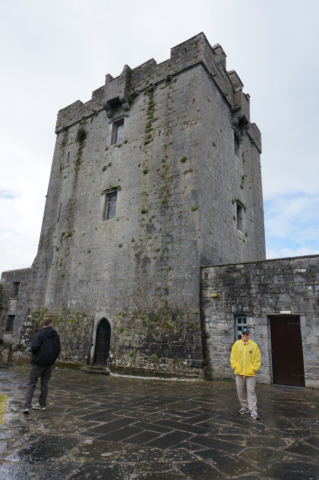 Dad standing in front of tower of Dunguaire Castle