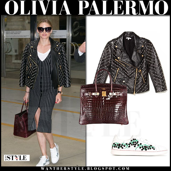 Olivia Palermo in black studded leather rebecca minkoff jacket, black striped dress and white sneakers moncler muguet what she wore