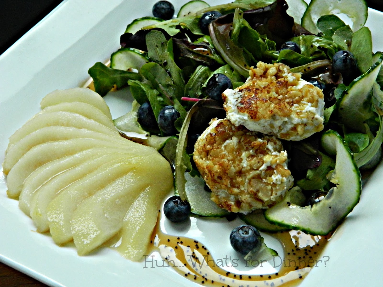 Hun... What's for Dinner?: Mixed greens paired with a maple poached pear, blueberries, walnut crusted goat cheese and drizzled with a maple poppy seed dressing.