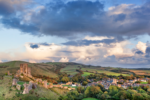 Dorset village of Corfe Castle is bathed in the evening sunlight