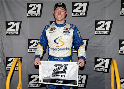 Tyler Reddick, driver of the #29 Cooper Standard Ford, poses with 21 Means 21 pole award after qualifying in Bristol, Tennessee.