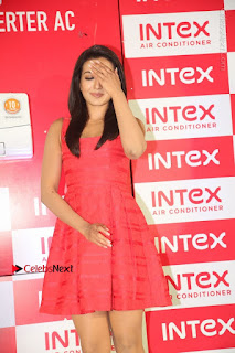 Catherine Tresa Latest Pictures in Red Short Dress at Intex Air Conditioners Launch