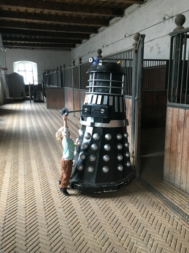 a-dalek-a-pokemon-a-pier-toddler-reaching-up-to-touch-a-dalek-at-Tredegar-house-stables