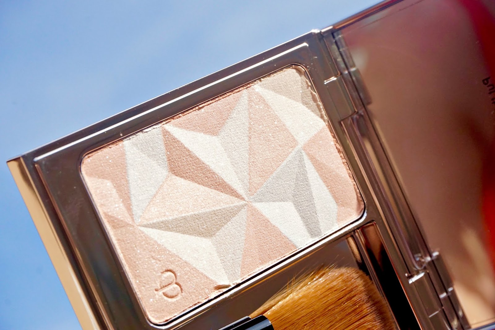 cle de peau luminizing face enhancer #18 swatches