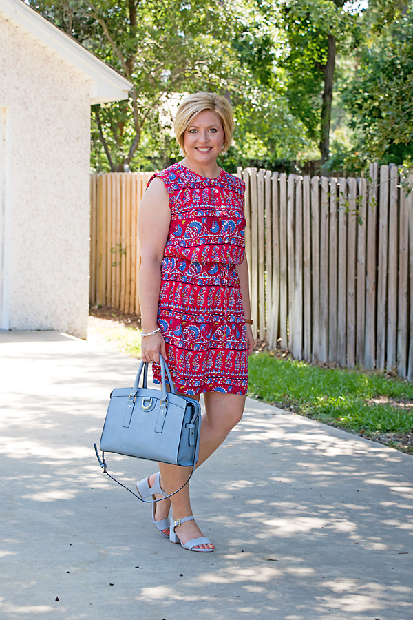 print dress with blue sandals