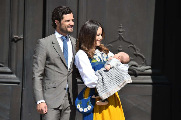 Prince Carl Philip, Princess Sofia Hellqvist and son Prince Alexander open the gate of the Royal Palace for the National Day Celebrations