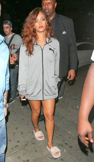 Rihanna leaves only a coat and slippers
