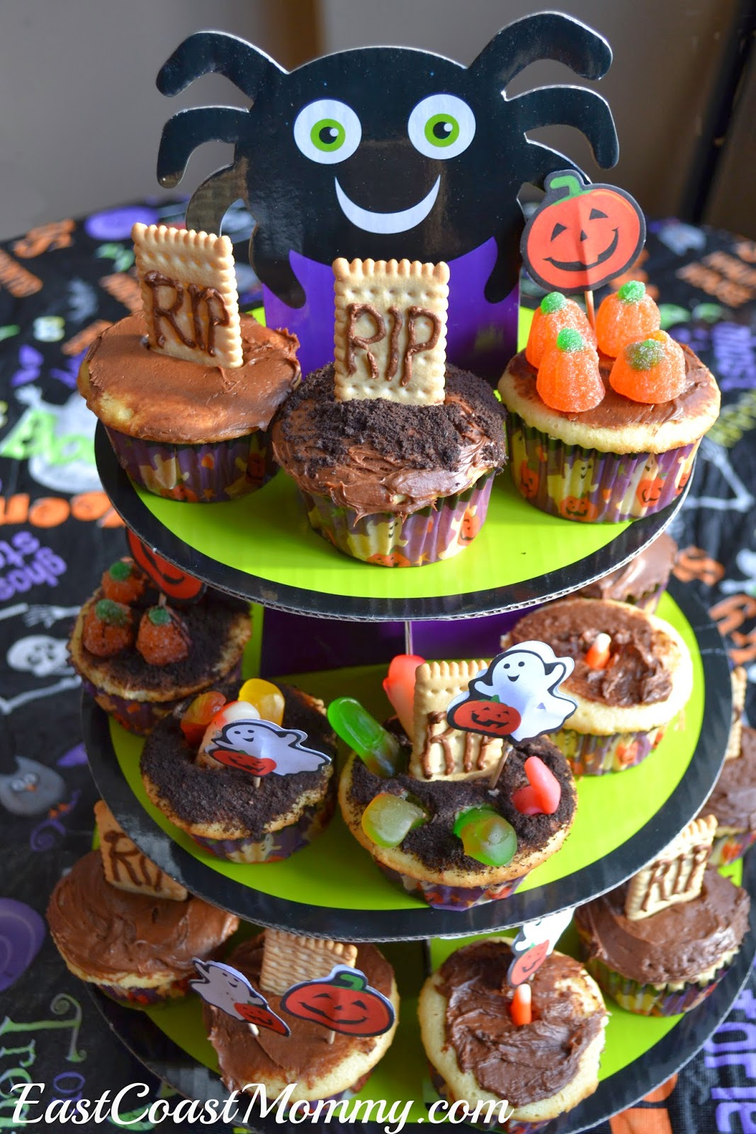 for their creations they used cupcakes icing oreo cookie crumbs candy corn tombstone cookies and gummy fingers