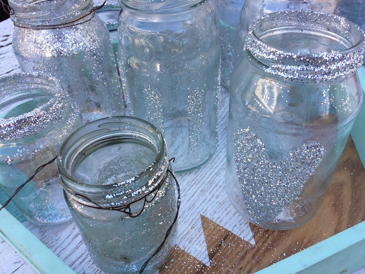 jar lanterns - just lather with gluestick and then dip in glitter...