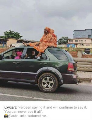 Woman Spotted Sitting On Top Of A Moving SUV