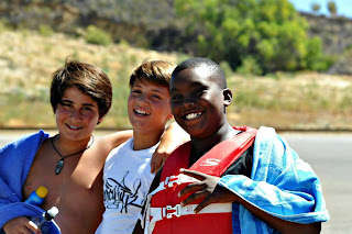 Three teenage boys hanging out together at Castaic Lake