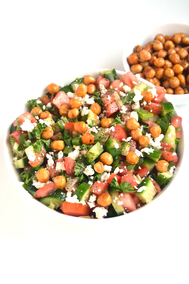 Greek Chopped Salad with Roasted Chickpeas is so delicious with chopped cucumber, tomato, green onion, parsley, feta cheese, crunchy roasted chickpeas and a fresh lemon vinaigrette for a delicious, nutritious side dish! www.nutritionistreviews.com