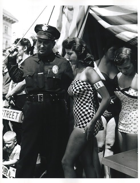 Venice Boardwalk in 1960s. Police officer escorts beauty contestants. Hey Ladies. marchmatron.com