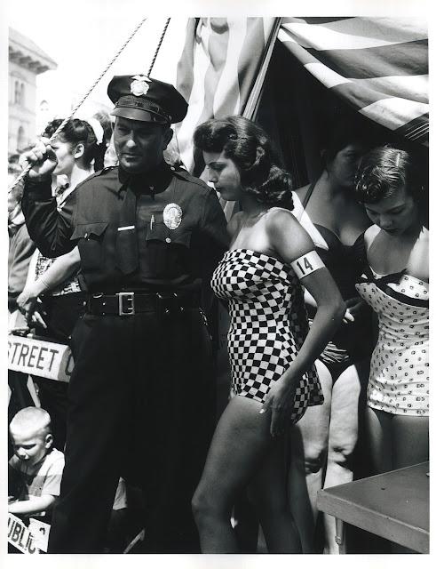 Venice Boardwalk in 1960s. Police officer escorts beauty contestants. Hey Ladies. marchmatron.com