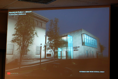 screen grab of the presentation showing the new Library at night