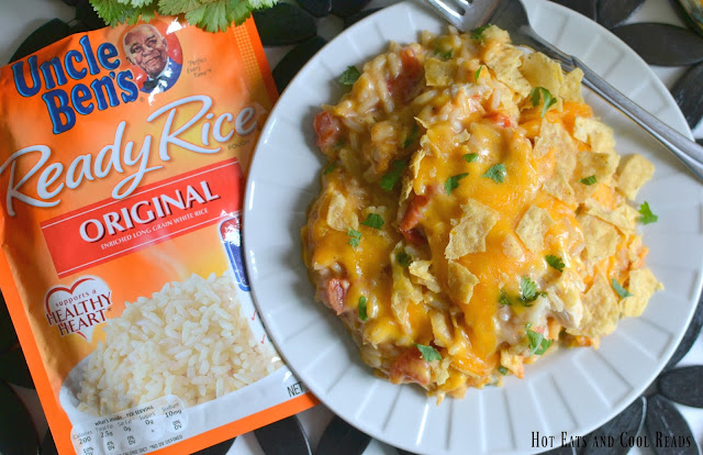 A delicious and family friendly casserole! Perfect for those busy weeknights or even Sunday dinner! Budget friendly too! Cheesy Fiesta Chicken and Rice Casserole Recipe from Hot Eats and Cool Reads