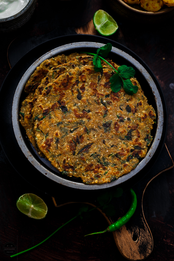 Methi Dhebra or Thepla, A delicious classic Gujarati flatbread prepared with fresh fenugreek leaves, multigrain flour and basic spices. It pairs well with dry potato sabji, yogurt, pickle or tea.