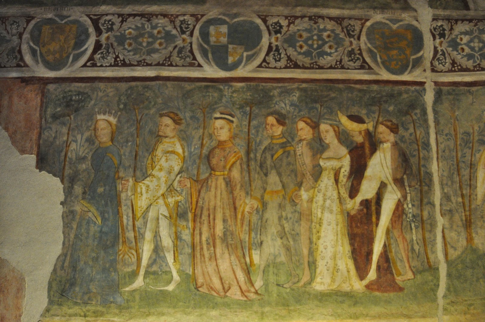 Fresco of procession with smiling ladies and sad lords