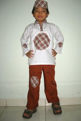 Model Baju Muslim Anak Laki-laki Dengan Peci