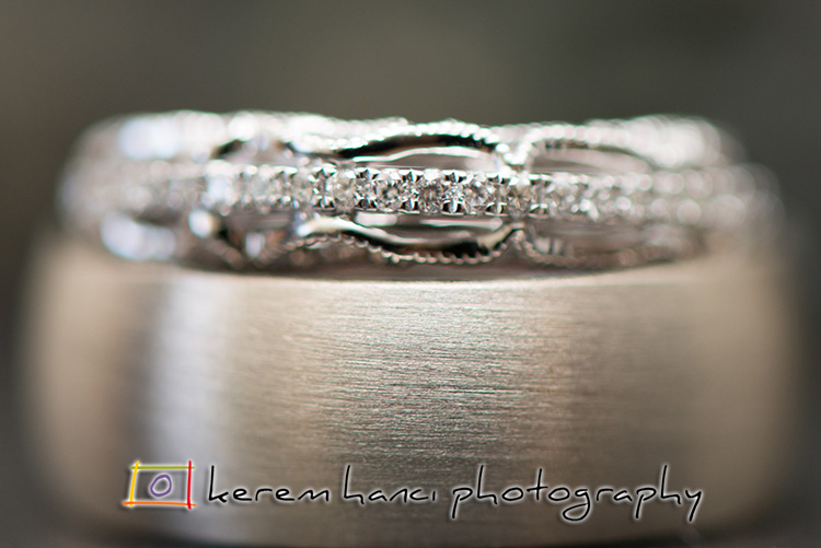 Here is another approach to wedding ring shots: extreme close up with a very narrow depth of field.
