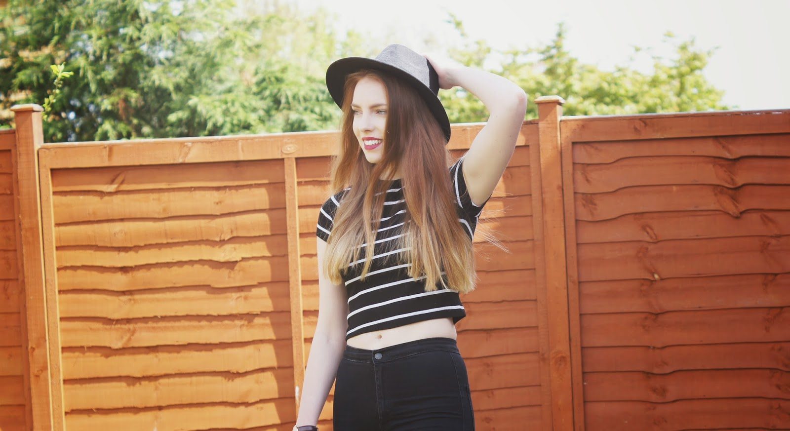 stripy crop top and black hat