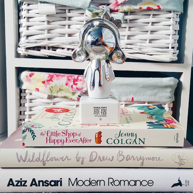 book pile: jenny colgan, aziz anzari, drew barrymore,