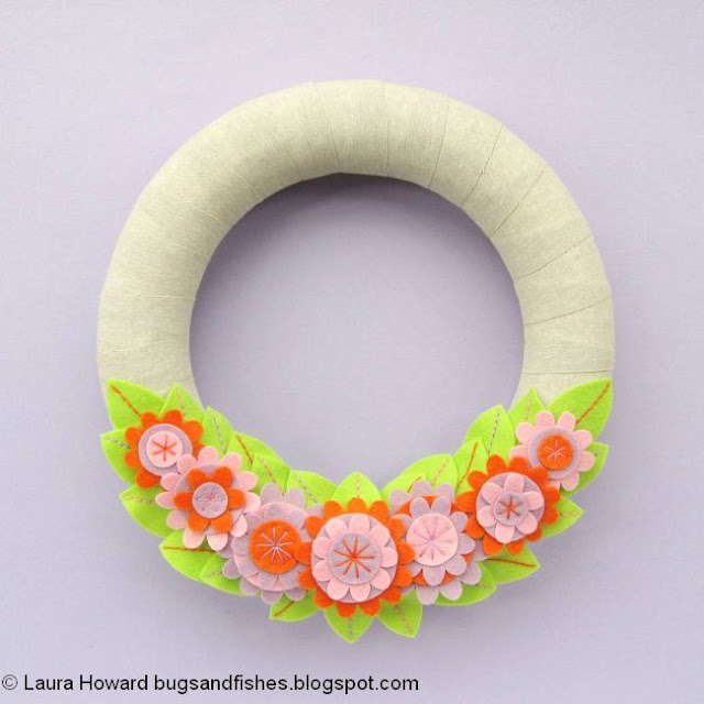 make a wreath decorated with felt flowers and leaves