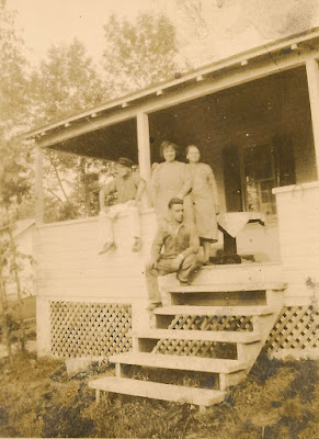 Mystery Photo! A group of two men and two women on the porch of a house in the country. All unidentified.