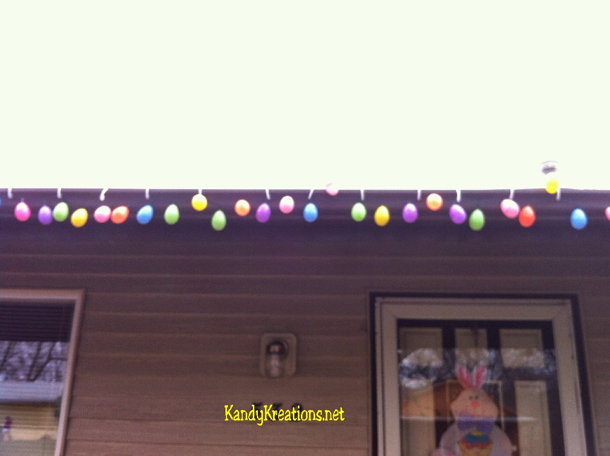 Make beautiful and easy Easter Egg lights for your front porch using old christmas lights and some Easter eggs.