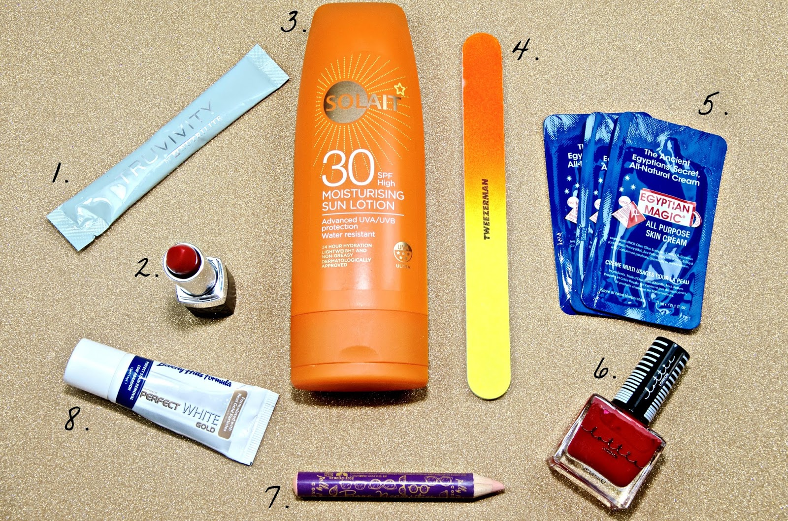 red lipstick, sun cream, toothpaste, nail file, nail polish and beauty products