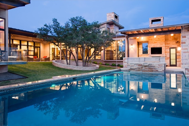 Photo of an amazing modern home as seen from the pool area