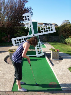Emily playing the Windmill hole at Bognor Regis Mini Golf