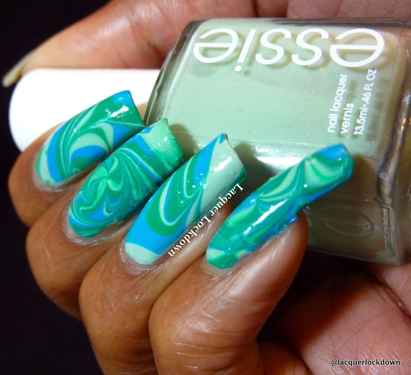 Lacquer Lockdown - watermarble nail art, watermarble nails, watermarble, ocean water marble nail art, swirling nail art, pinwheel watermarble, nail art, cute nai art ideas, essie Fashion Playground, Essie Strut Your Stuff, Essie Ruffles and Feathers