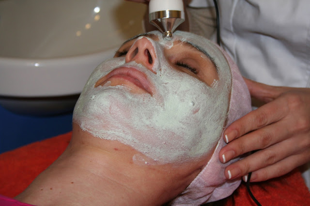 woman pampering face mask spa
