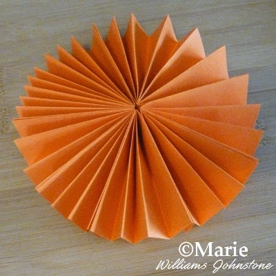 Folded round circular paper decoration for hanging up