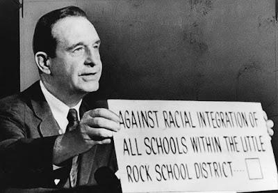 Democrat Arkansas Governor Orville Faubus tried to prevent desegregation of a Little Rock public school.