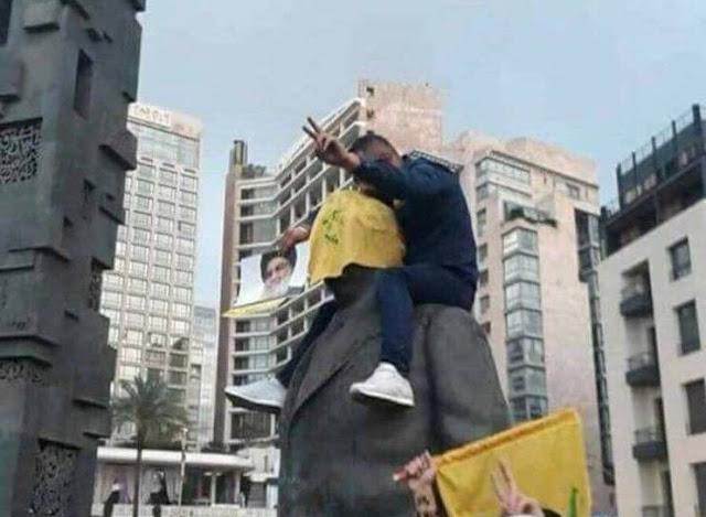 مليشيات حزب الله  اللبناني تدنس رموز الدوله اللبنانيه .