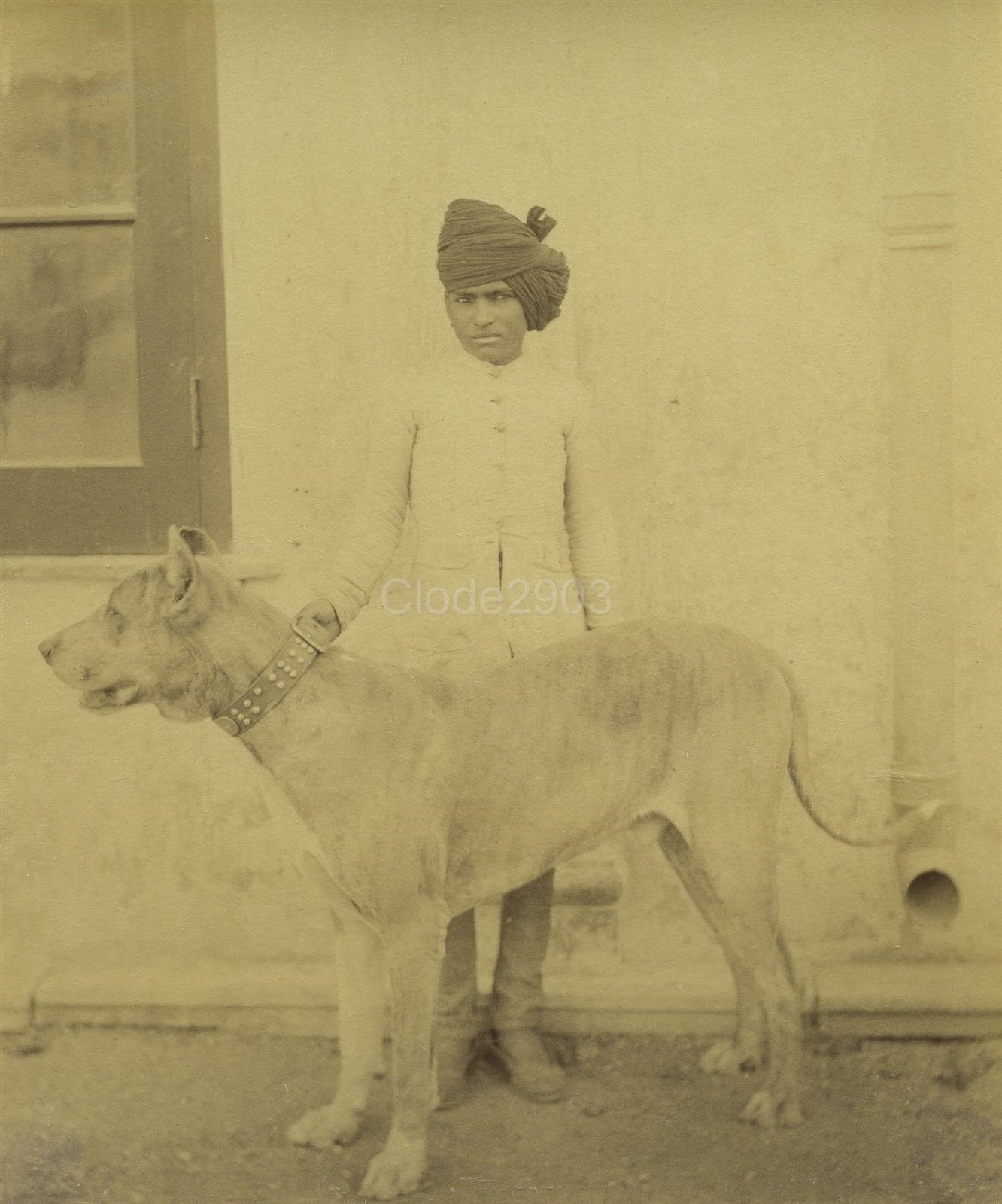 Indian Man Holding a Collared Dog - c1890's