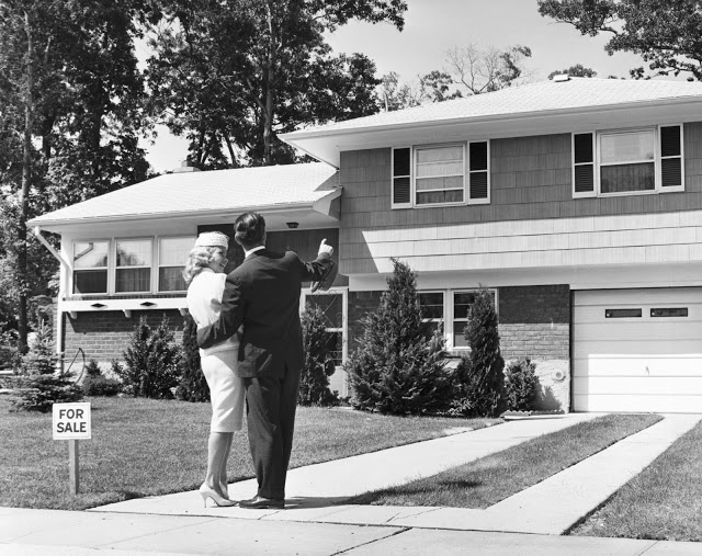 Newlyweds in the 1950s house shopping in the suburbs. The Burbs and Other stories of The Haves and The Have Nots. Marchmatron.com