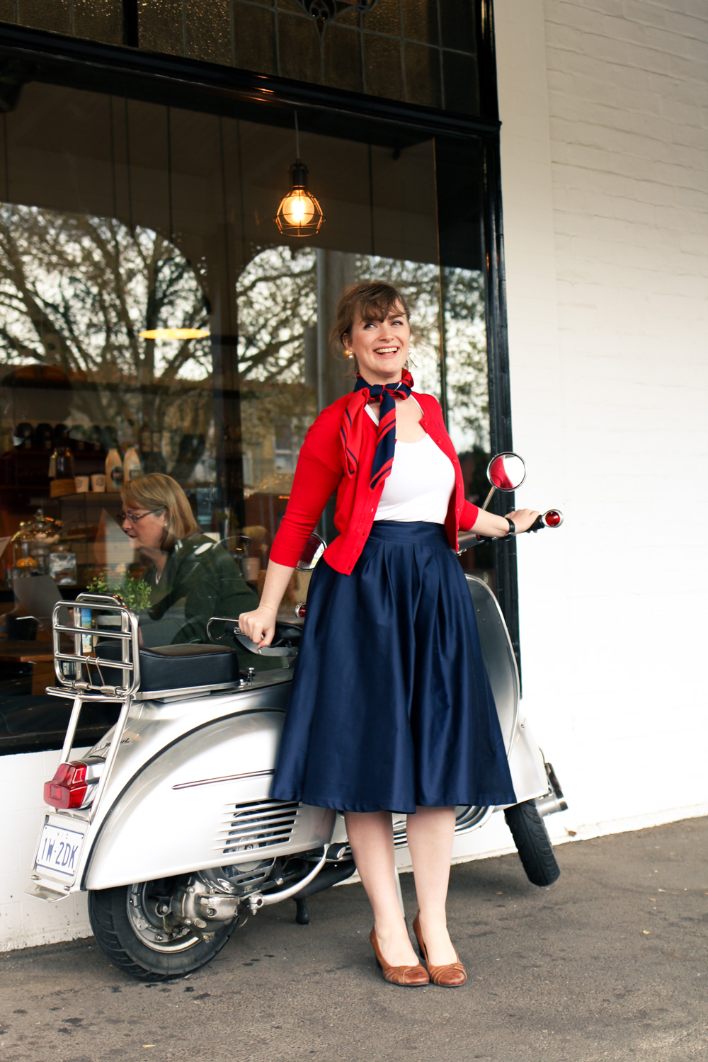 @findingfemme wears red, embroidered cardigan by Review Australia at The Tin Roof in Ballarat.