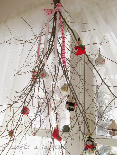 Twigs decorated with Christmas ornaments